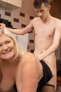Granny is fucked by young boy in kitchen