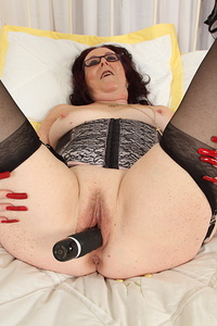 Naughty British mature lady playing with her pussy