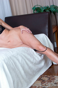 American mom Sofie Marie wants you to admire her sexy skinny body, so she peels off her miniskirt dress and then slips her bra and thong off with a flirty smile. This horny housewife can't keep her hands away from her bare cunt, only stopping to grab a vibrator that will finish the job.