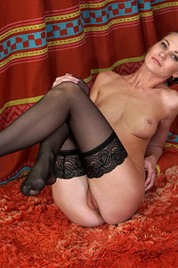 Get ready for lusty Tatiana, a tall slim Russian housewife who's happy to peel off her bra and thong for your pleasure! She's slow to take her clothes off, but once she's down to just her thigh high stockings she slips her hand between her slim thighs to show you just how she wants her bare cunt caressed.