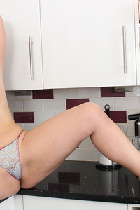 Naughty housewife Montse gets horny in her kitchen